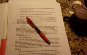 Red pen and coffee mug with Edison's draft work.